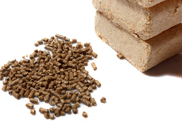sawdust briquettes and pellets on white background