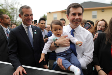 U.S. Democratic presidential candidate Mayor Pete Buttigieg picks up a baby as he campaigns with Los Angeles Mayor Eric Garcetti in Los Angeles