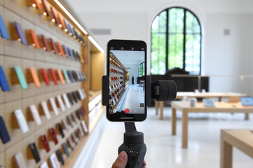 An Apple Store employee demonstrates an iPhone gimbal during the grand opening and media preview of the new Apple Carnegie Library store in Washington