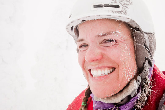 Portrait of a woman backcountry skier with ice on her face.