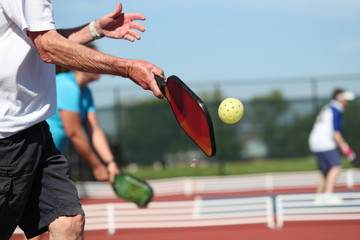 Pickleball is played outdoors