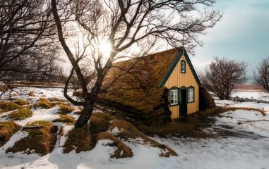 Landscape of turf church Hofskirkja in small village of Hof Iceland