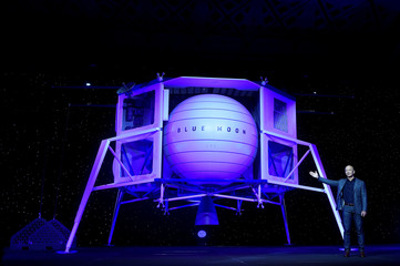 Founder, Chairman, CEO and President of Amazon Jeff Bezos unveils his space company Blue Origin's space exploration lunar lander rocket called Blue Moon during an unveiling event in Washington