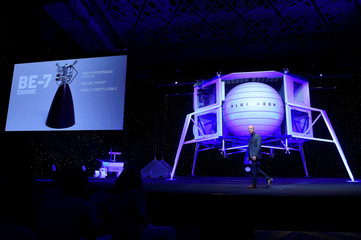Founder, Chairman, CEO and President of Amazon Jeff Bezos unveils the BE-7 rocket engine that his space company Blue Origin's space exploration lunar lander rocket called Blue Moon will use during an unveiling event in Washington