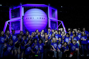 Founder, Chairman, CEO and President of Amazon Jeff Bezos poses with children from 'Club of the Future' after his space company Blue Origin's space exploration lunar lander rocket called Blue Moon was unveiled at an event in Washington
