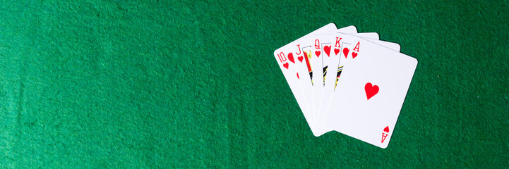 Royal flush of hearts on green background. Winning hands of poker playing cards