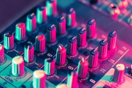 Close up of a pro mixing desk in a home recording studio