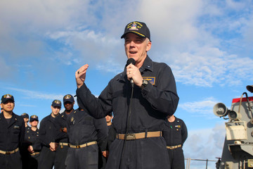 Handout photo of U.S. Navy Rear Admiral Jim Malloy commander of Carrier Strike Group 10, addresses the crew of the guided-missile destroyer USS Mason in the Atlantic Ocean