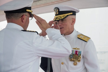 Handout photo of U.S. Navy Rear Admiral Jim Malloy (R), commander of Carrier Strike Group 10, is saluted during a change of command ceremony onboard the USS Dwight D. Eisenhower during deployment in Norfolk, Viginia