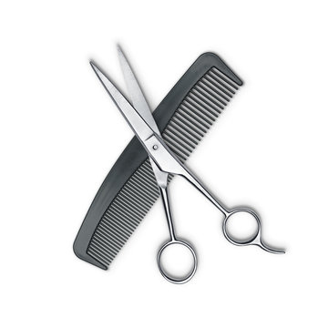Hair cutting shears and comb isolated on white