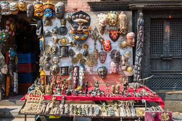 Wooden masks and handicrafts on sale at shop in the Thamel market, Thamel District of Kathmandu, Nepal.