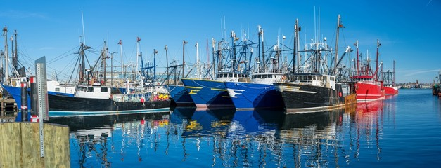 Landscape panoramic view of Commercial phishing boats harbor, repair shop