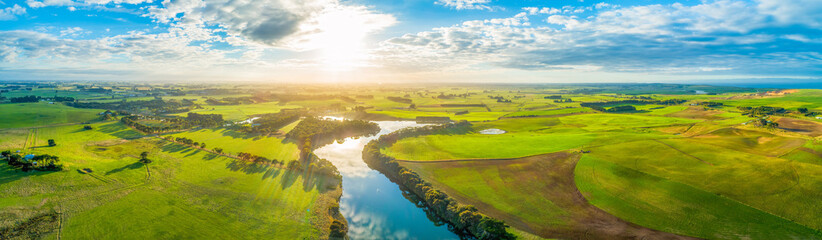 Aerial panoramic landscape of scenic sunset over river and grasslands in Australia Fototapete