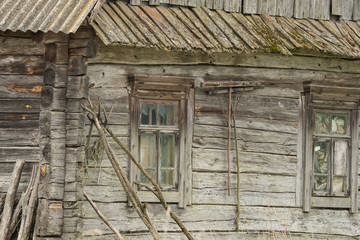 An old wooden house with agricultural tools. Komory village. Polesie. Ukraine.