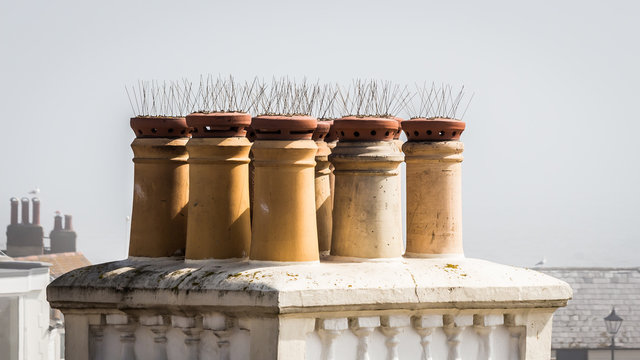 Anti-pigeon spikes on the chimneys of a house in the UK