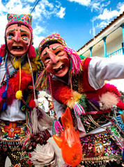 Paucartambo, Cusco, Peru - Circa July 2013: Men dancing and wearing typical masks at Paucartambo's religious festival of Virgen del Carmen. Colorful traditional 'Capaq Qolla' dancers with folkloric at