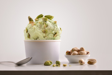 Composition of pistachio ice cream ball in paper cup