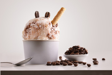 Composition of coffee ice cream ball in paper cup