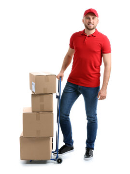 Handsome delivery man with boxes on white background