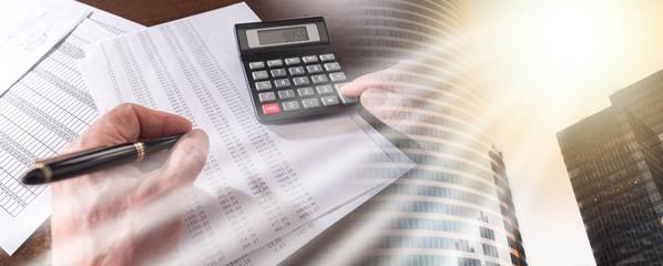 Male hand using calculator; multiple exposure
