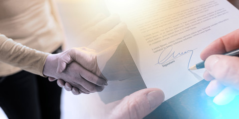 Signing of a contract and handshake; multiple exposure
