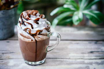 Papiers peints Chocolat Hot chocolate cocoa in glass mug with whipped cream