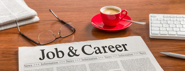 A newspaper on a wooden desk - Job and Career