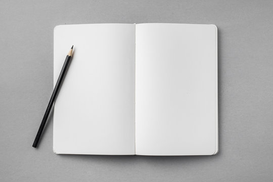 white notebook isolated on grey background