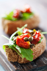Whole grain rusk with rocket