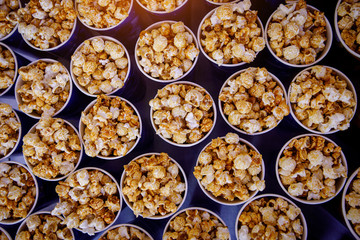 Many cups of popcorn before the movie