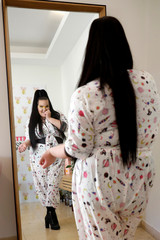 Israeli singer, Netta Barzilai, winner of the 2018 Eurovision Song Contest, poses for a picture as she looks at herself in the mirror during her interview with Reuters in Tel Aviv
