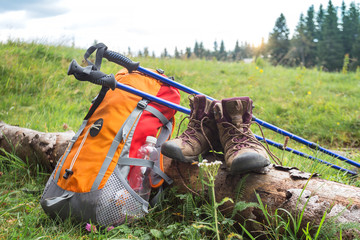 backpack, boots and Trekking poles