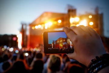 Smartphone in hand record outdoor music show
