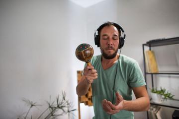 Printed kitchen splashbacks Artist KB Musician playing maracas in home music studio.