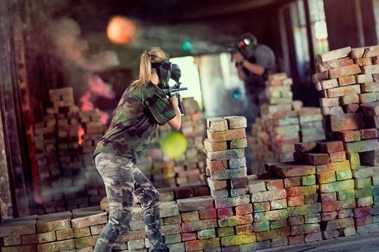 opposite players in paintball game