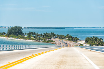 Sanibel Island, USA bay during sunny day, toll bridge highway road causeway with colorful water and cars