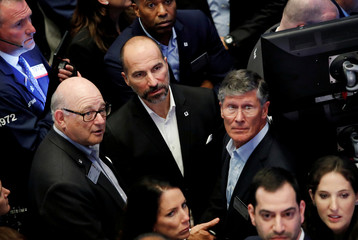 Uber Technologies Inc. CEO Dara Khosrowshahi, Chairman Ronald Sugar and board member John Thain on trading floor of NYSE during the company's IPO in New York