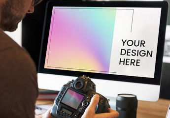 Photographer Working with Computer Design Mockup