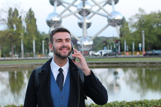 Businessman calling by phone with copy space
