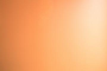 Blur pastel color sweet dreamy clouds background. orange peach color