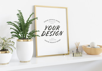 Vertical Frame Leaning on Shelf with Plants and Books Mockup