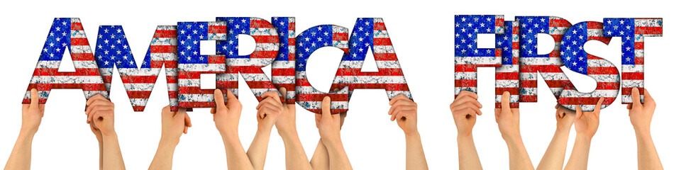 people arms hands holding up wooden letter lettering forming words maerica first with USA stars spangled banner national flag colors tourism travel elections concept isolated white background