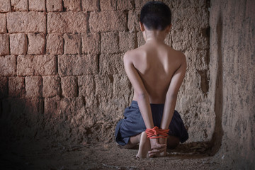 A victim tied up with rope. Human trafficking concept.