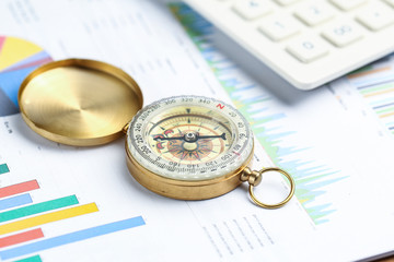 compass, calculator on financial graph, Business investment concept