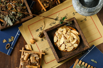 Chinese traditional herbal medicine in steelyard. Translation reads as chinese herbal therapy.