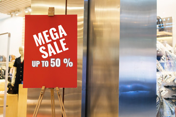 Mockup red poster sale offer menu frame advertising billboard at front department store background for show present promotion product. Background layout insert space for text information to customer