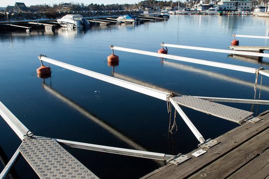 Oslo Norway, empty marina moorings in icy water