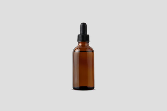 Amber Bottle for essential oils and cosmetic products. Glass bottle on white background. A dropper, a bottle with a sprayer, a jar. Mockup isolated on white