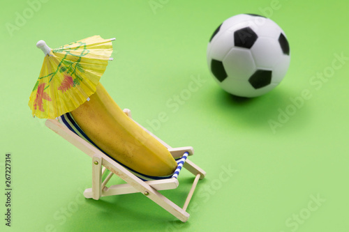 Pleasant A Banana Is Lying In A Lounge Chair On A Green Background Beatyapartments Chair Design Images Beatyapartmentscom