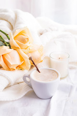 Morning romantic coffee served to bed with bunch of beige roses in shabby chic style interior, romantic bed breakfast or coffee